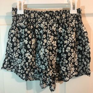Floral black shorts with white flower design.